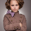 Serious stylish little girl looking at camera — Stock Photo #5250520