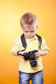 Little photographer watch photo on camera — Stock Photo