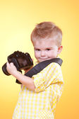 Little cute photographer showing professional camera — Stock Photo