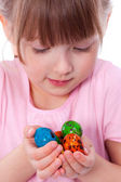 Cute girl with Easter eggs at hands — Stock Photo