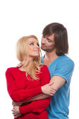 Young happy loving couple looking at each other — Stockfoto