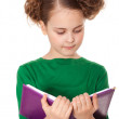 Interested girl reading book — Stock Photo