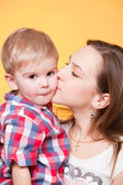 Happy mom kissing little son — Stock Photo