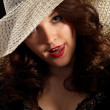 Flirty woman in a hat — Stock Photo #3946716