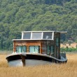 Houseboat in rushy shallow waters of bay — Stock Photo
