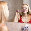 Young pretty woman brushing her teeth — Stock Photo #4294157