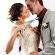 Bride pulling groom by his tie for a kiss — Stock Photo #4294223
