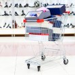 Shopping cart loaded with shoe boxes in a shoe department — Stock Photo #4294236