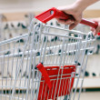 Woman pushing shopping cart in shoe store, close-up — Stock Photo #4294248