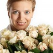 Young woman with bunch of roses — Stock Photo