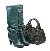 Green female high-heeled boots and leather bag on the white background — Stock Photo
