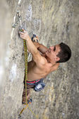 Rock climber on the cliff, vertical view — Stock Photo