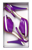 Female violet summer shoes in box isolated on white. With path — Stock Photo