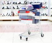 Shopping cart loaded with shoe boxes in a shoe department — Stock Photo