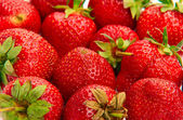 Macro shot of strawberries piled up — Stock Photo