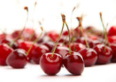 Ripe red cherries on white background — Stock Photo