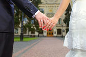 Wedding photo of married couple holding hands — Stock Photo