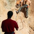 Two rock climbers, one belaying — Stock Photo #4768899