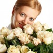 Stock Photo: Young blue-eyed womwith bunch of creamy roses