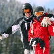 Portrait of smiling couple on skis — Stock Photo #4769107