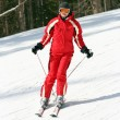 Female skier on a slope — Stock Photo