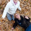 Two female friends having fun in autumn park — Stock Photo