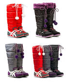Colorful female winter boots on the white background — Stock Photo