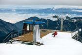 Station of the ski lift, female skier on chairlift. — Stock Photo