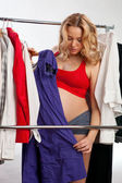 Beautiful pregnant woman choosing what to wear — Stock Photo