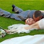 Portrait of happy newlyweds on grass — Stock Photo #5369557