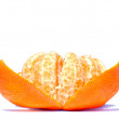Partly peeled mandarin on the white surface — Stock Photo
