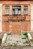 The old dilapidated building of red bricks — Stock Photo