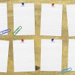 Stock Photo: Set of reminders on wooden bulletin board