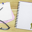 Stock Photo: Notebook, reminders and sunglasses on table
