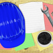 Stock Photo: Protective helmet with cup of hot coffee, and various stuff on