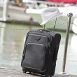 Suitcase at the yacht harbor — Stock Photo