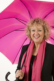Curly Lady with pink umbrella — Stock Photo