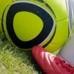 Постер, плакат: Jabulani Soccer ball and football boots