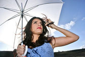 Girl under sun-protection umbrella — Stock Photo