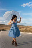 Girl playing with umbrella — Stock Photo