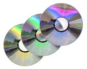 Three colored CD / DVD disks isolated on White — Stock Photo