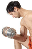Young pretty muscleman with dumbbell — Stock Photo