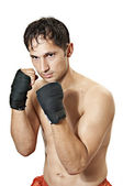 Kickboxer or boxer is in protection position. — Stock Photo