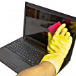 Clearing laptop of viruses — Stock Photo