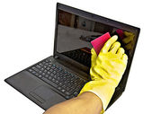 Clearing laptop of viruses — Stok fotoğraf