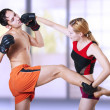 Woman fighter punching man in head - Stock Photo