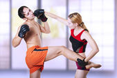 Woman fighter punching man in head — Stock Photo