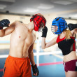 Two person training kickboxing on ring — Stock Photo