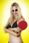 Sexy woman with table tennis racket — Stock Photo