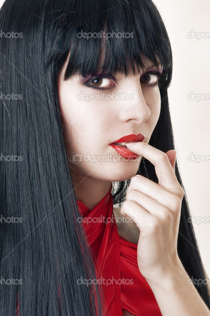 Fashion portrait of brunette woman with seductive red lips, big eyes and long black hair. Makeup.  — Stock Photo #4822085